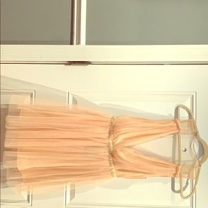 Tulle party dress, color is a neutral peach